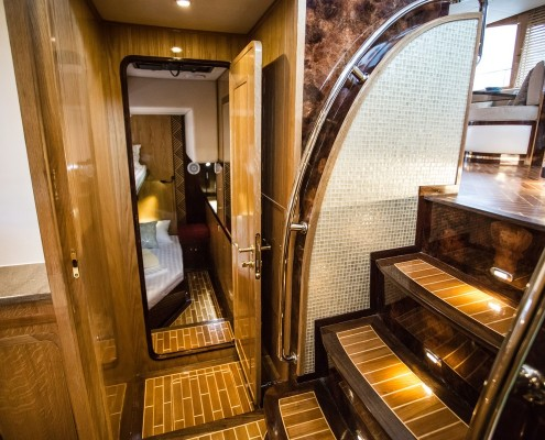 Luxury-Power-Catamaran-Spacoius-corridors-wood-art-work